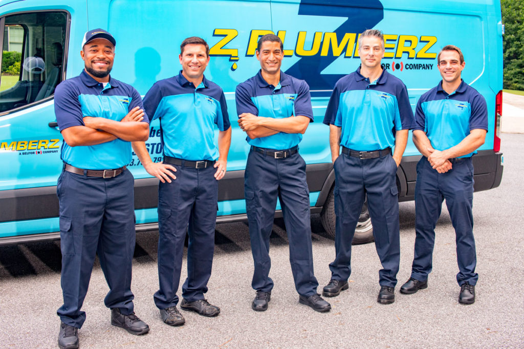 Z PLUMBERZ franchise owners in front of car
